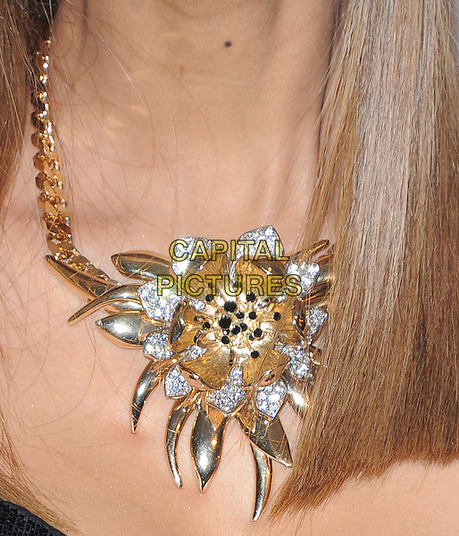 Tyra Banks' necklace .at The  Pre-GRAMMY Gala & Salute to Industry Icons with Clive Davis Honoring Antonio L.A. Reid held at The Beverly Hilton Hotel in Beverly Hills, California, USA, February 9th 2013.                                                               .detail gold necklace shiny beaded flower .CAP/DVS.©Debbie VanStory/Capital Pictures.