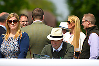 A racegoers studies the race card during Afternoon Racing at Salisbury Racecourse on 16th May 2019
