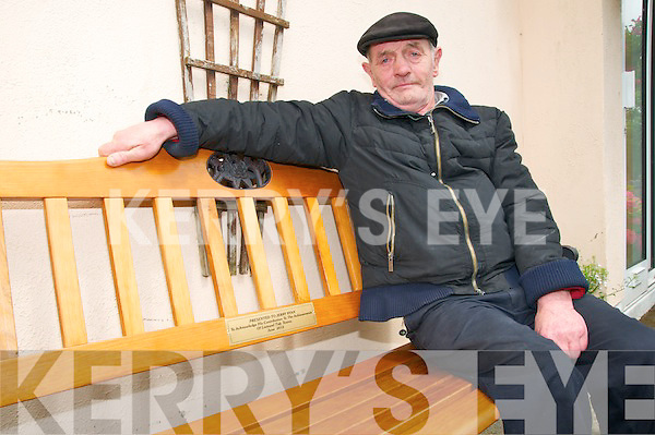 Gerry Ryan , retired member of Listowel Urban Council relaxing on the seat presented to him in recognition of his contribution to the achievements of Listowel Tidy Towns