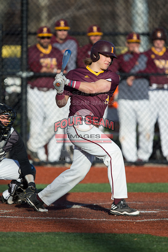 Joe DeMaio (14) of the Iona Gaels follows through on his swing against the Rutgers Scarlet Knights at City Park on March 8, 2017 in New Rochelle, New York.  The Scarlet Knights defeated the Gaels 12-3.  (Brian Westerholt/Four Seam Images)