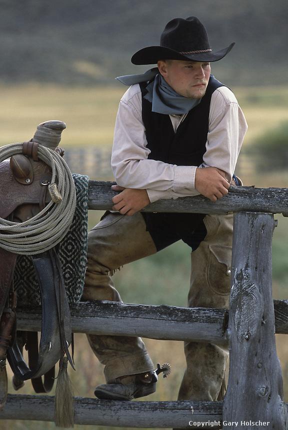 Cowboy leaning on fence.  Ponderosa Ranch. Senaca OR.  MR