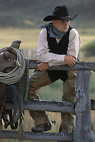 Cowboy leaning on fence.  Ponderosa Ranch. Senaca OR.  MR
