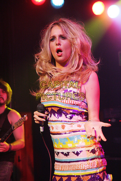 DIANA VICKERS.Performing live at the Scala, London, England..May 12th, 2010.stage concert live gig performance music half length white purple blue yellow pattern print tribal dress hand palm mouth open funny.CAP/MAR.© Martin Harris/Capital Pictures.