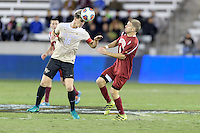 Houston, TX -  Friday, December 9, 2016:  Ian Harkes (16) of the Wake Forest Demon Deacons heads the ball away from Blake Elder (6) of the Denver Pioneers in the first half of the  NCAA Men's Soccer Semifinals at BBVA Compass Stadium.