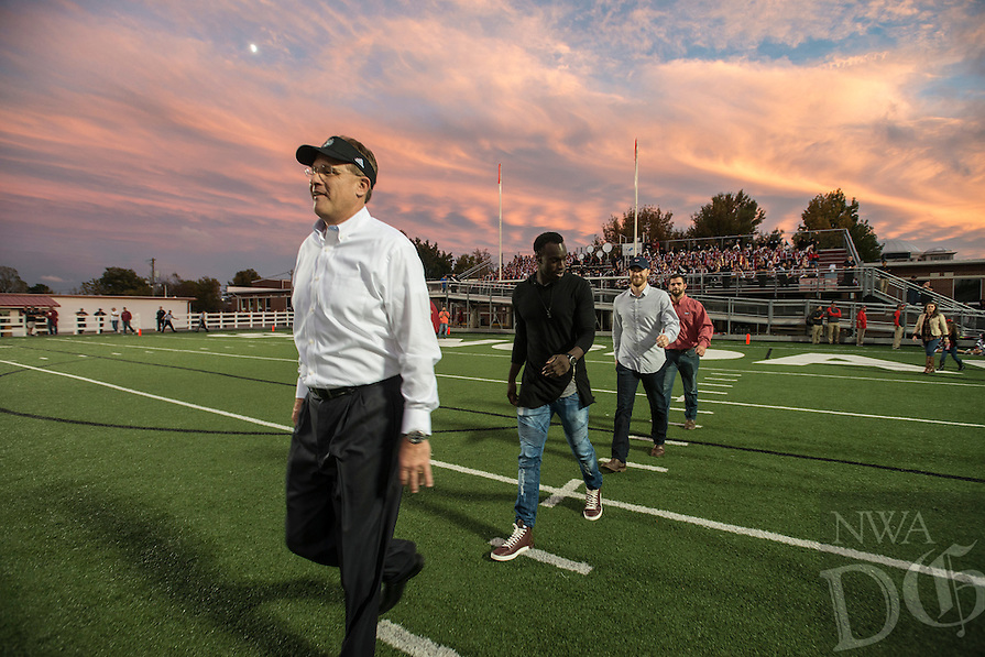 NWA Democrat-Gazette/ANTHONY REYES &bull; @NWATONYR<br /> Gus Malzahn (left) former head football coach for Springdale walks onto the field against Fort Smith Northside Friday, Oct. 23, 2015 at Jarrell Williams Bulldog Stadium in Springdale. Malzahn and the 2005 undeated championship team reunited on homecoming.