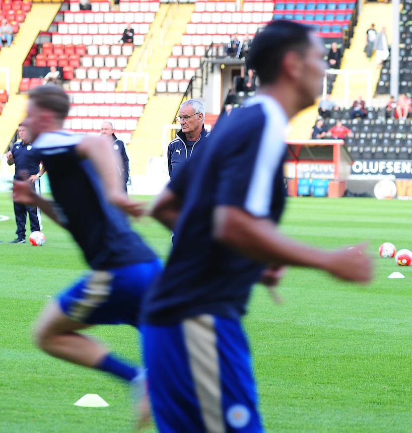 Leicester City Manager Claudio Ranieri casts an eye over his team's pre-match warm-up<br /> <br /> Photographer Chris Vaughan/CameraSport<br /> <br /> Football - Football Friendly - Lincoln City v Leicester City - Tuesday 21st July 2015 - Sincil Bank - Lincoln<br /> <br /> &copy; CameraSport - 43 Linden Ave. Countesthorpe. Leicester. England. LE8 5PG - Tel: +44 (0) 116 277 4147 - admin@camerasport.com - www.camerasport.com