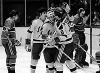 Seals score against Buffalo Sabers Gary Croteau, Walt McKechnie and Pete Laframboise.(1974 photo/Ron Riesterer)