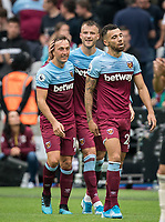 Andriy Yarmolenko of West Ham Utd celebrates his goal with Mark Noble of West Ham Utd during the Premier League match between West Ham United and Manchester United at the Olympic Park, London, England on 22 September 2019. Photo by Andy Rowland / PRiME Media Images.