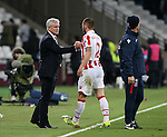 Stoke's Mark Hughes shakes hands with Phil Bardsley at the final whistle during the Premier League match at the London Stadium, London. Picture date November 5th, 2016 Pic David Klein/Sportimage