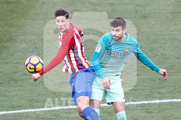 Atletico de Madrid's Fernando Torres (l) and FC Barcelona's Gerard Pique during La Liga match. February 26,2017. (ALTERPHOTOS/Acero)