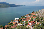 Lin-Pogradec-Albania - August 02, 2004---Partial view of the peninsula and the village of Lin, with its church, and the Lake Ohrid (wih Macedonian mountains and shore at the horizon); region/village of project implementation by GTZ-Wiram-Albania (German Technical Cooperation, Deutsche Gesellschaft fuer Technische Zusammenarbeit (GTZ) GmbH); landscape-religion---Photo: Horst Wagner/eup-images