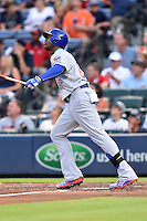 Chicago Cubs right fielder Jorge Soler (68) swings at a pitch during a game against the Atlanta Braves on July 18, 2015 in Atlanta, Georgia. The Cubs defeated the Braves 4-0. (Tony Farlow/Four Seam Images)