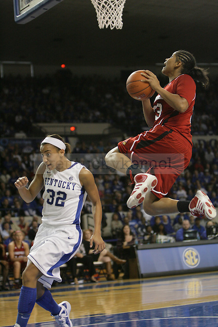 Sophomore guard Kastine Evans runs underneath the basket on a breakaway play by Louisville during the second half of UK Hoop's home game against Louisville at Memorial Coliseum in Lexington, Ky., Dec. 4, 2011. UK defeated Louisville 74-54. Photo by Brandon Goodwin | Staff