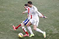 Atletico de Madrid's Juanfran Torres (l) and Real Madrid's Cristiano Ronaldo during La Liga match.February 7,2015. (ALTERPHOTOS/Acero) /NORTEphoto.com