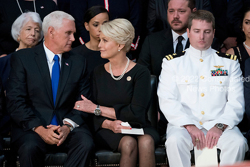 Cindy McCain, wife of, Sen. John McCain, R-Ariz., right, talks with Vice President Mike Pence, left, after he speaks at a ceremony for John McCain as he lies in state in the Rotunda of the U.S. Capitol, Friday, Aug. 31, 2018, in Washington. Also pictured is McCain's son Navy Lt. Jack McCain, right. (AP Photo/Andrew Harnik, Pool)