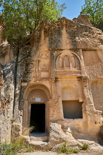"Pictures & images of Kalburlu (St. Epthemios) church decorative sculptures, 9th century, the Vadisi Monastery Valley, ""Manastır Vadisi"",  of the Ihlara Valley, Guzelyurt , Aksaray Province, Turkey.<br /> <br /> Kalburlu (St. Epthemios) church dates back to the 9th or 10th century. It is carved out of a single rock massive with rock columns holding up the roof of its church . The arches of Kalburlu (St. Epthemios) church have rich architectural decorated relif sculptures. The naves are connected by rounded arches & there is a baptismal font to the east of the main entrance."