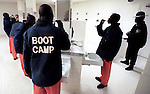 Lt. Lawrence Wilson (R) watches as juveniles in one of the boot camp platoons brush their teeth after eating lunch at the Leon County Jail in Tallahassee, Florida