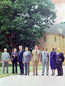 """Class photo"" of the G-7 leaders from the Economic Summit in front of the Colonial Capitol in Williamsburg, Virginia on May 29, 1983.  From left to right:  Prime Minister Pierre Trudeau of Canada, President Gaston Thorn of the European Commission, Chancellor Helmut Kohl of West Germany, President Francois Mitterrand of France, President Reagan, Prime Minister Yasuhiro Nakasone of Japan, Prime Minister Margaret Thatcher of the United Kingdom, and Prime Minister Amintore Fanfani of Italy.<br /> Credit: Arnie Sachs / CNP"
