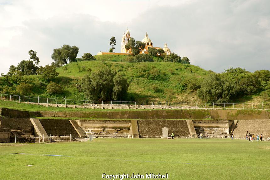 Pre-Hispanic ruins at southern base of Tapaneca Pyramid  and Santuario de Nuestra Senora de los Remedios church in Cholula, Puebla, Mexico. Cholula is a UNESCO World Heritage Site.