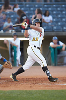 Mason Martin (23) of the West Virginia Power follows through on his swing against the Lexington Legends at Appalachian Power Park on June 7, 2018 in Charleston, West Virginia. The Power defeated the Legends 5-1. (Brian Westerholt/Four Seam Images)