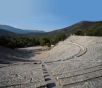EPIDAURUS, GREECE - APRIL 14 : A view from above of the Theatre, on April 14, 2007 in Epidaurus, Greece. The Theatre, designed by Polykleitos the Younger, was built in the late 4th century BC and extended in the Hellenistic period. It was rediscovered in 1881 and significantly restored in the 1950s.  It has the three main features of a Greek theatre: the orchestra, a sunken round stage; the skene, a raised rectangular stage; and the cavea, a raked semi-circular auditorium with radiating diazomas, or aisles, one of which is central to this image. The theatre is renowned for its accoustics thanks to the symmetry of the cavea, and for its beautiful mountain view, seen here in the late afternoon light. (Photo by Manuel Cohen)