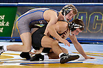 BROOKINGS, SD - JANUARY 11:  Isaac Andrade from South Dakota State controls Max Soria from Buffalo during their 125 pound match at Frost Arena Sunday afternoon in Brookings. (Photo by Dave Eggen/Inertia)