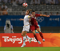 USWNT captain (3) Christie Rampone goes up for a header with  Canadian forward (14) Melissa Tancredi while playing at Shanghai Stadium.  The US defeated Canada, 2-1, in extra time and advanced to the semifinals during the 2008 Beijing Olympics in Shanghai, China.