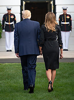 United States President Donald J. Trump and first lady Melania Trump return to the Diplomatic Entrance of the White House after observing a moment of silence at 8:46am EDT in commemoration of  the 18th anniversary of the terrorist attacks on the World Trade Center in New York, NY and the Pentagon in Washington, DC on Wednesday, September 11, 2019.<br /> Credit: Ron Sachs / CNP /MediaPunch