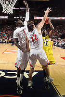 CHARLOTTESVILLE, VA- NOVEMBER 29: Assane Sene #5 of the Virginia Cavaliers and Joe Harris #12 of the Virginia Cavaliers defend Tim Hardaway Jr. #10 of the Michigan Wolverines during the game on November 29, 2011 at the John Paul Jones Arena in Charlottesville, Virginia. Virginia defeated Michigan 70-58. (Photo by Andrew Shurtleff/Getty Images) *** Local Caption *** Tim Hardaway Jr.;Joe Harris;Assane Sene