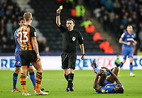 Referee Tony Harrington shows a yellow card to Hull City's Stephen Kingsley for a foul on Bolton Wanderers' Clayton Donaldson <br /> <br /> Photographer Andrew Kearns/CameraSport<br /> <br /> The EFL Sky Bet Championship - Hull City v Bolton Wanderers - Tuesday 1st January 2019 - KC Stadium - Hull<br /> <br /> World Copyright © 2019 CameraSport. All rights reserved. 43 Linden Ave. Countesthorpe. Leicester. England. LE8 5PG - Tel: +44 (0) 116 277 4147 - admin@camerasport.com - www.camerasport.com