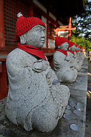 Jizo statues on Mount Takao. Pilgrims place one coin before each statue as they pray.