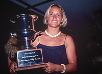 Lisa Andersen (USA) 1994 Women's World Surfing Champion with her world title trophy. Photo: joliphotos