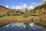 Lake reflection of Vail Valley and Gore Range, with fall Aspen trees, Colorado. John offers autumn photo tours throughout Colorado. .  John leads private photo tours throughout Colorado. Year-round Colorado photo tours.