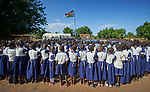 Students assemble around the national flag at the beginning of the day in a primary school in Bunj, South Sudan, sponsored by Jesuit Relief Service. The community is host to more than 130,000 refugees from the Blue Nile region of Sudan. JRS, with support from Misean Cara, provides educational and psycho-social services to both refugees and the host community.