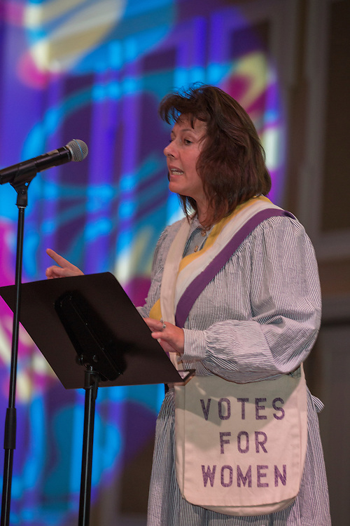 Monica Hatfield Price, an alumna of the Scripps College of Communication and a current doctoral candidate in the Patton College of Education, presents on women's suffrage during the International Women's Festival on March 13, 2016. Audience members were encouraged to boo or cheer during certain parts of the presentation. Photo by Emily Matthews