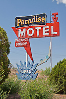 The restored neon sign in front of the Paradise Motel in Tucumcari, New Mexico on route 66.