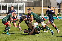 Jason Harries of London Scottish is tackled by Tiff Eden of Nottingham Rugby (2nd left) and Jordan Coghlan  of Nottingham Rugby (2nd right) during the Greene King IPA Championship match between London Scottish Football Club and Nottingham Rugby at Richmond Athletic Ground, Richmond, United Kingdom on 15 April 2017. Photo by David Horn.