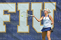 18 March 2012:  FIU's Giulietta Boha returns the ball during her singles match against Columbia's Katarina Kovacevic as the Columbia Lions defeated the FIU Golden Panthers, 5-2, at University Park in Miami, Florida.