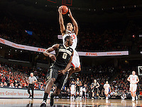Virginia guard Malcolm Brogdon (15) shoots over Wake Forest guard Codi Miller-McIntyre during the game Wednesday Jan. 08, 2014 in Charlottesville, Va. Virginia defeated Wake Forest 74-51.
