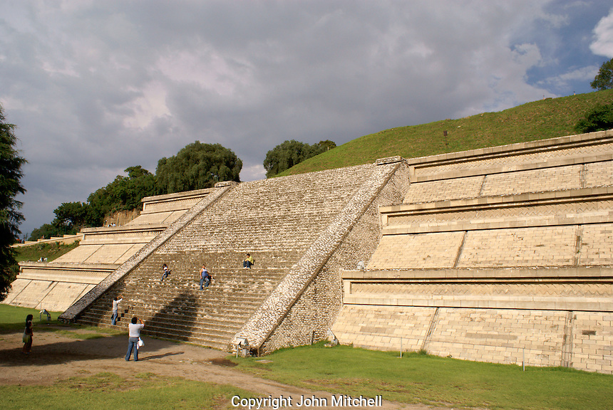People climbing the reconstructed base of Tapaneca Pyramid's west side  in Cholula, Puebla, Mexico. Cholula is a UNESCO World Heritage Site.