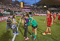 Portland, Oregon - Wednesday June 22, 2016: Portland Thorns FC goalkeeper Michelle Betos (18) receives roses for her shutout during a regular season National Women's Soccer League (NWSL) match at Providence Park.