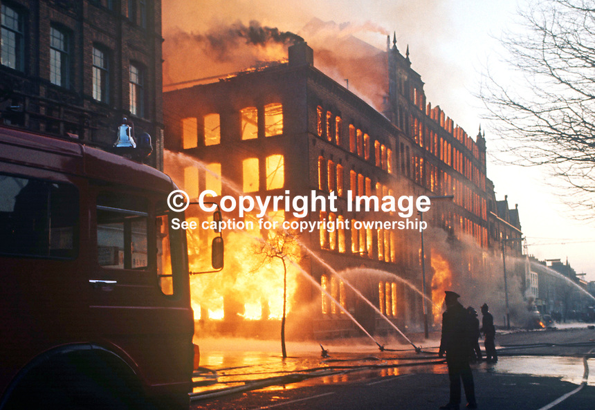 Firemen at the scene of a blaze in a mixed use building, Dublin Road, Belfast, N Ireland following Provisional IRA explosion, January, 1972, 197201000011<br />
