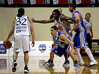 Paul Henare prepares to pass to Kareem Johnson as Luke Martin and Kevin Owens try to defend during the NBL Basketball match between the Wellington Saints and Bay Hawks, TSB Bank Arena, Wellington, New Zealand on Saturday, 10 May 2008. Photo: Dave Lintott / lintottphoto.co.nz