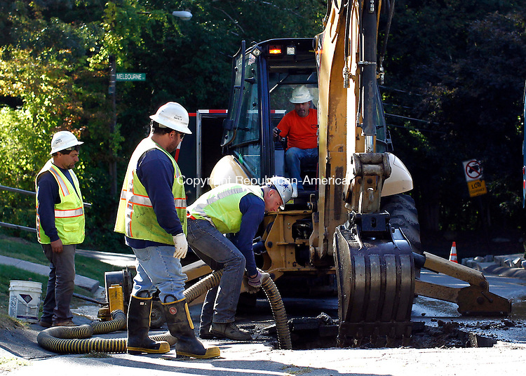 Waterbury, CT- 19 September 2014-091914CM01-  Crews from the Waterbury Bureau of Water investigate a water main break on Bonair Ave in Waterbury on Friday.  The crews cut a section of asphalt near the intersection of Melbourne Terrace to determine the cause of the rupture.    Christopher Massa Republican-American