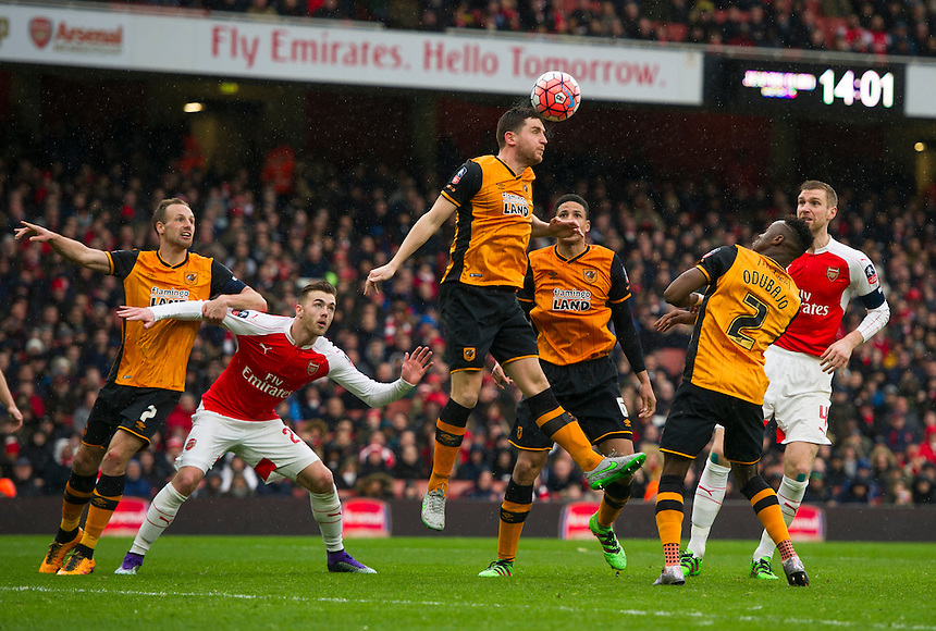 Hull City's Alex Bruce clears another Arsenal attack<br /> <br /> Photographer Ashley Western/CameraSport<br /> <br /> Football - The FA Cup Fifth Round - Arsenal v Hull City - Saturday 20th February 2016 - Emirates Stadium - London<br /> <br /> &copy; CameraSport - 43 Linden Ave. Countesthorpe. Leicester. England. LE8 5PG - Tel: +44 (0) 116 277 4147 - admin@camerasport.com - www.camerasport.com