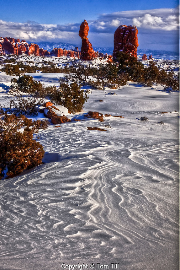 Snow patterns at Balanced Rock,  Arches National Park,  Utah,   After heavy snow, La Sal Mountains beyond, Entrada Sandstone