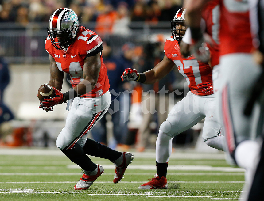 Ohio State Buckeyes linebacker Curtis Grant (14) intercepts a pass during the second quarter of the NCAA football game against the Illinois Fighting Illini at Ohio Stadium on Nov. 1, 2014. (Adam Cairns / The Columbus Dispatch)