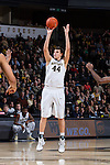 Dinos Mitoglou (44) of the Wake Forest Demon Deacons fires up a jump shot during first half action against the Pittsburgh Panthers at the LJVM Coliseum on March 1, 2015 in Winston-Salem, North Carolina.  The Demon Deacons defeated the Panthers 69-66.  (Brian Westerholt/Sports On Film)