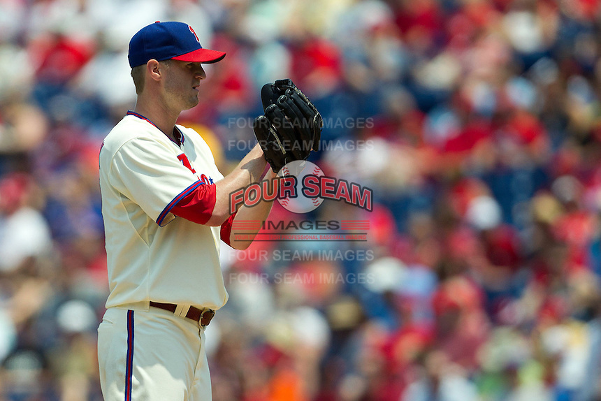 Philadelphia Phillies pitcher Kyle Kendrick #38 looks in for the sign during the Major League Baseball game against the Pittsburgh Pirates on June 28, 2012 at Citizens Bank Park in Philadelphia, Pennsylvania. The Pirates defeated the Phillies 5-4. (Andrew Woolley/Four Seam Images).
