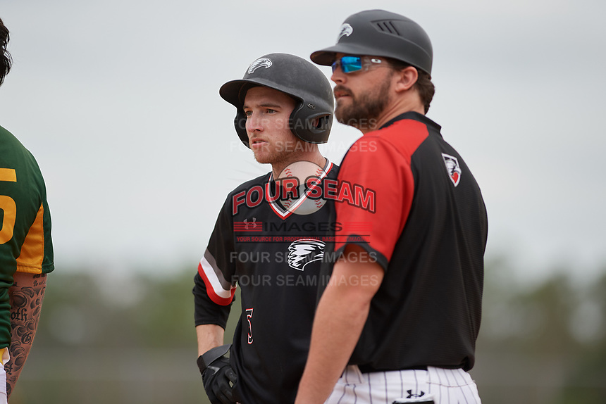 Edgewood Eagles left fielder Ryan Cassady (5) and coach Ralph Kalal during a game against the South Vermont Mountaineers on March 18, 2019 at Lee County Player Development Complex in Fort Myers, Florida.  South Vermont defeated Edgewood 19-6.  (Mike Janes/Four Seam Images)